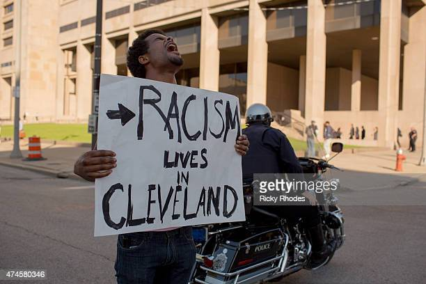 Tanis Quach of Cleveland protests in front of the Justice Building People take to the streets and protest in reaction to Cleveland police officer...
