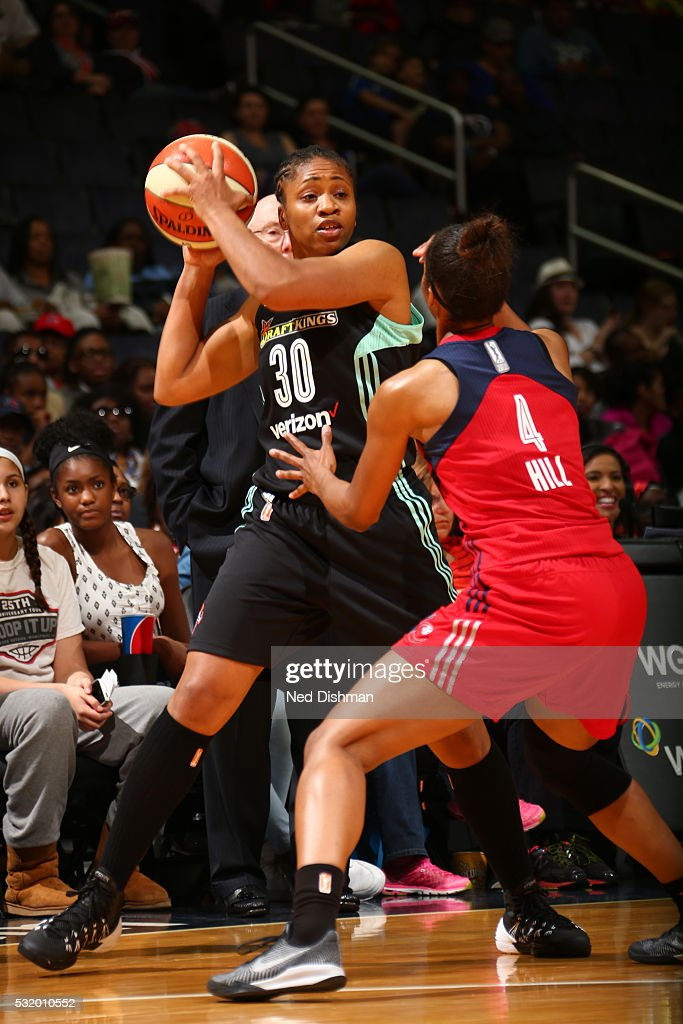 Tanisha Wright #30 of New York Liberty handles the ball during the game against Tayler Hill #4 of Washington Mystics on May 14, 2016 at Verizon Center in Washington, DC.