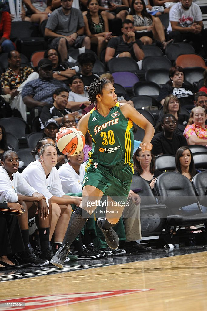 <a gi-track='captionPersonalityLinkClicked' href=/galleries/search?phrase=Tanisha+Wright&family=editorial&specificpeople=541423 ng-click='$event.stopPropagation()'>Tanisha Wright</a> #30 of the Seattle Storm drives against the San Antonio Stars at the AT&T Center on July 11, 2014 in San Antonio, Texas.