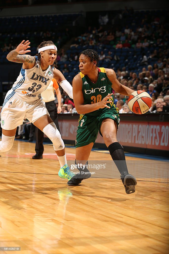 Tanisha Wright #30 of the Seattle Storm drives the basketball against Seimone Augustus #33 of the Minnesota Lynx during the WNBA Western Conference Semifinals Game 1 on September 20, 2013 at Target Center in Minneapolis, Minnesota.