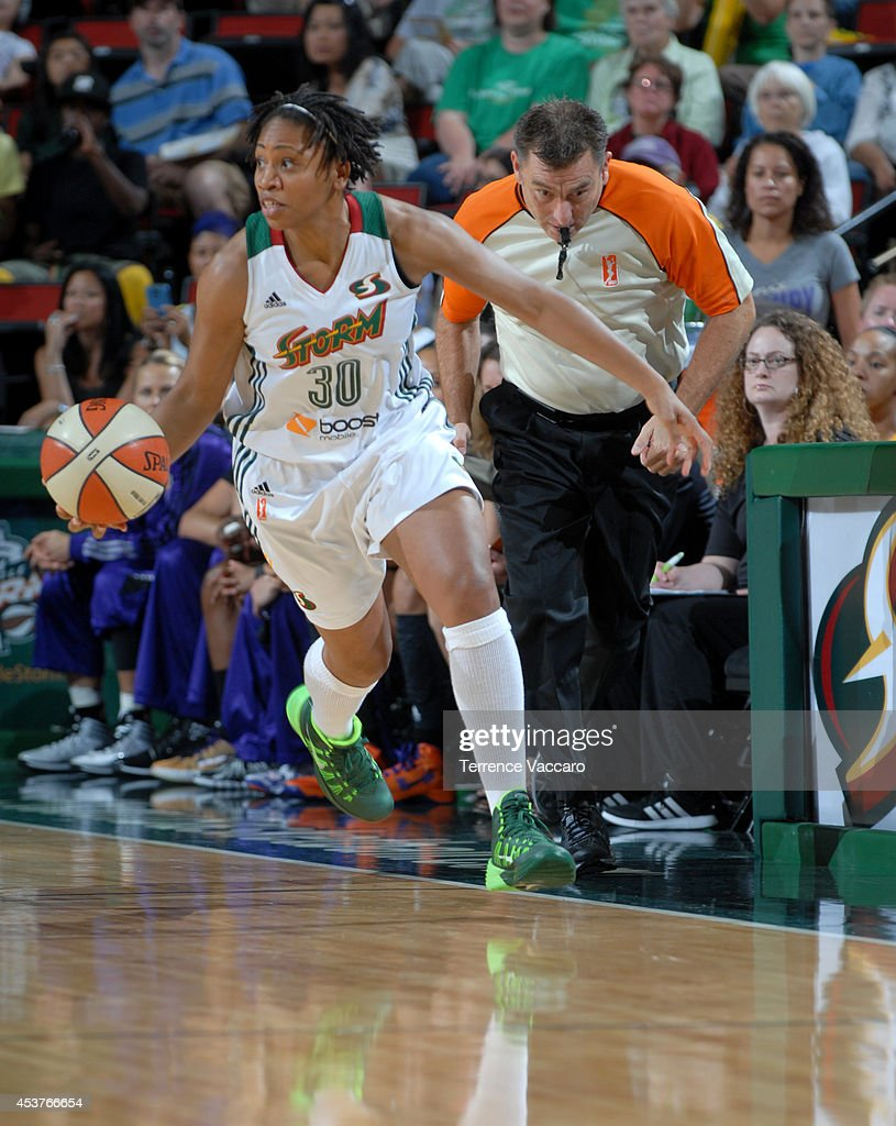 <a gi-track='captionPersonalityLinkClicked' href=/galleries/search?phrase=Tanisha+Wright&family=editorial&specificpeople=541423 ng-click='$event.stopPropagation()'>Tanisha Wright</a> #30 of the Seattle Storm handles the ball against the Phoenix Mercury during the game on August 17, 2014 at Key Arena in Seattle, Washington.