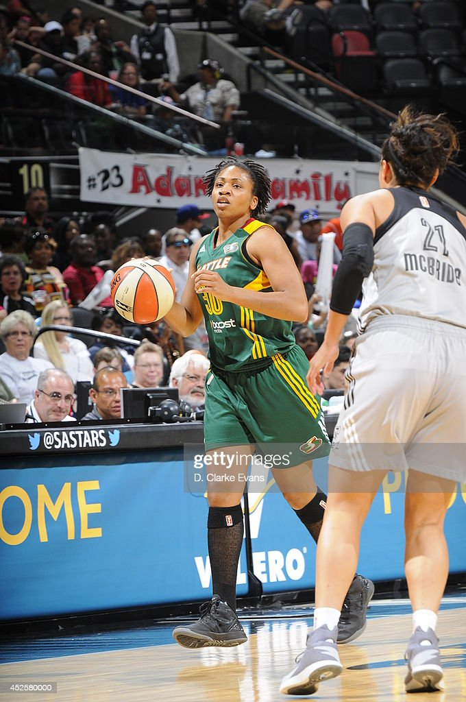 <a gi-track='captionPersonalityLinkClicked' href=/galleries/search?phrase=Tanisha+Wright&family=editorial&specificpeople=541423 ng-click='$event.stopPropagation()'>Tanisha Wright</a> #30 of the Seattle Storm moves the ball up-court against the San Antonio Stars at the AT&T Center on July 11, 2014 in San Antonio, Texas.