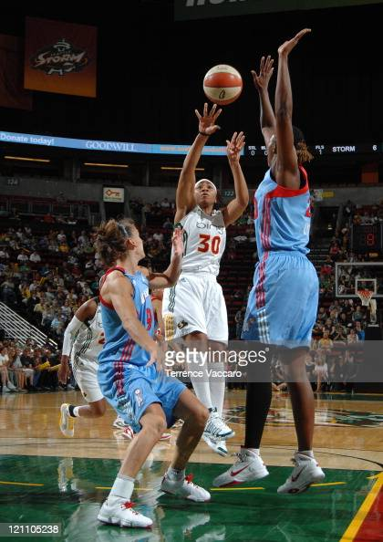 Tanisha Wright of the Seattle Storm shoots against Coco Miller of the Atlanta Dream during the game on August 13 2011 at Key Arena in Seattle...
