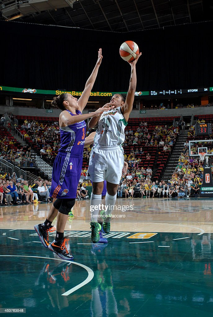 Tanisha Wright #30 of the Seattle Storm shoots against Diana Taurasi #3 of Phoenix Mercury during the game on August 17, 2014 at Key Arena in Seattle, Washington.