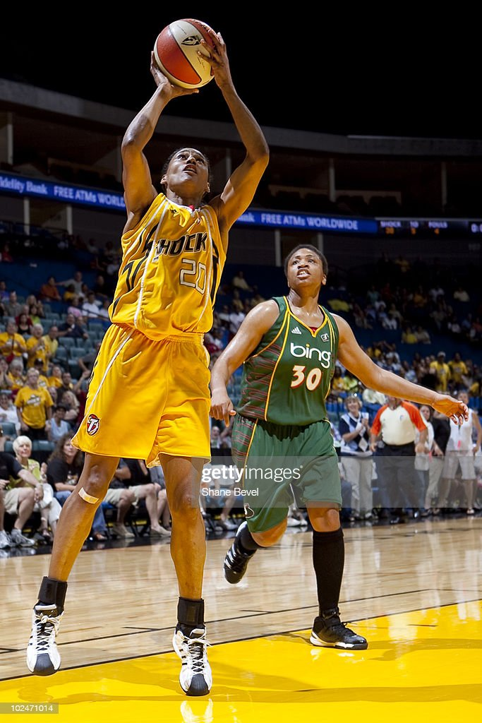 Tanisha Wright #30 of the Seattle Storm watches as Marion Jones #20 of the Tulsa Shock puts away a last minute shot at the end of the half during the WNBA game on June 27, 2010 at the BOK Center in Tulsa, Oklahoma. Seattle defeated Tulsa 83-72.