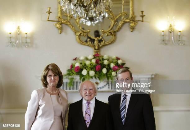 Taniste Joan Burton President Michael D Higgins and Taoiseach Enda Kenny at Aras an Uachtarain Dublin following today's cabinet reshuffle as the Fine...