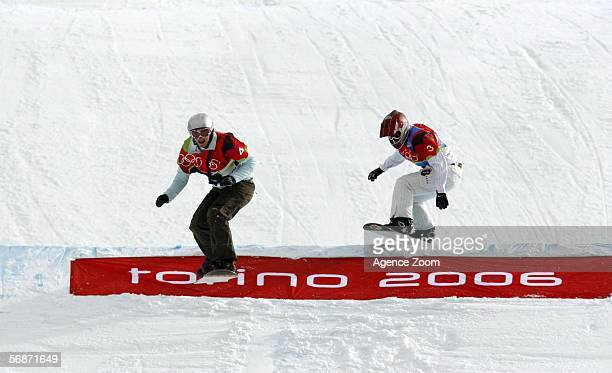 Tanja Frieden of Switzerland takes the leads over Lyndsey Jacobellis of the United States in the Womens Snowboard Cross Final on Day 7 of the 2006...