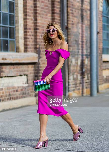 Tanja Gacic wearing a pink off shoulder dress from Yeojin Bae a Lucy Folg clutch Preen sunglasses and Gucci sandals outside Yeojin Bae at...