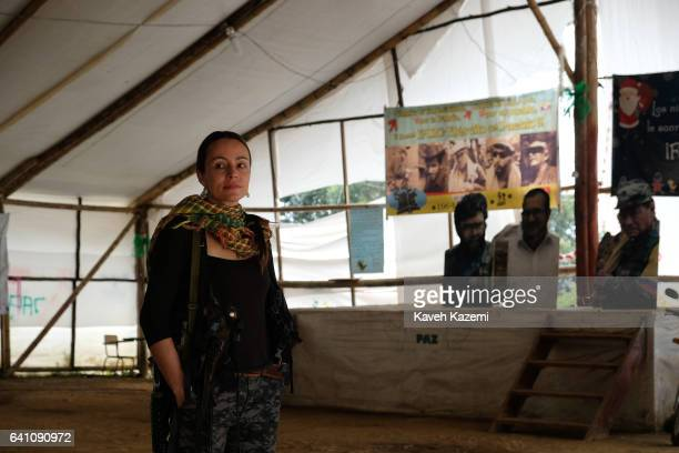 Tanja Nijmeijer a Dutch national with nom de guerre of Alexandra Nariño who joined FARC in 2002 stands in front of banners of past and present...