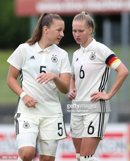 Tanja Pawollek and Janina Minge of Germany chat during the U19 women's elite round match between Germany and Switzerland at Friedensstadion on June 9...