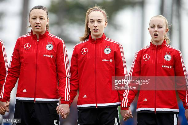 Tanja Pawollek Sophia Kleinherne and Caroline Siems of Germany line up during the national anthem prior to the U17 Girl's Euro Qualifier match...