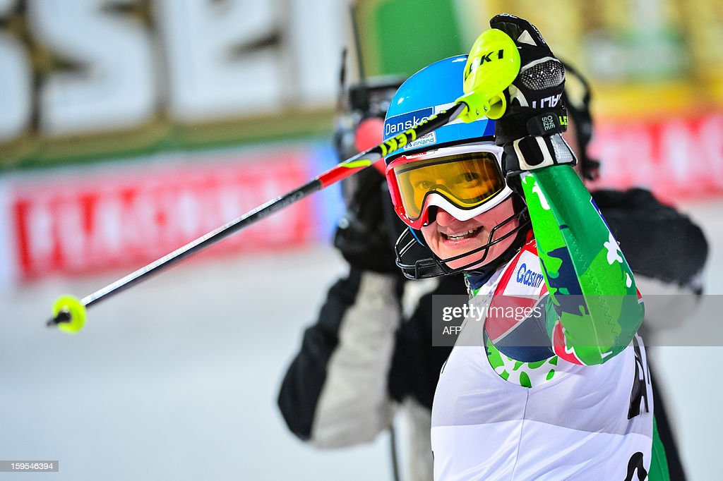 Tanja Poutiainen of Finland celebrates as she won the bronze medal of the FIS World Cup women's slalom in Flachau on January 15, 2013. AFP PHOTO / Jure Makovec