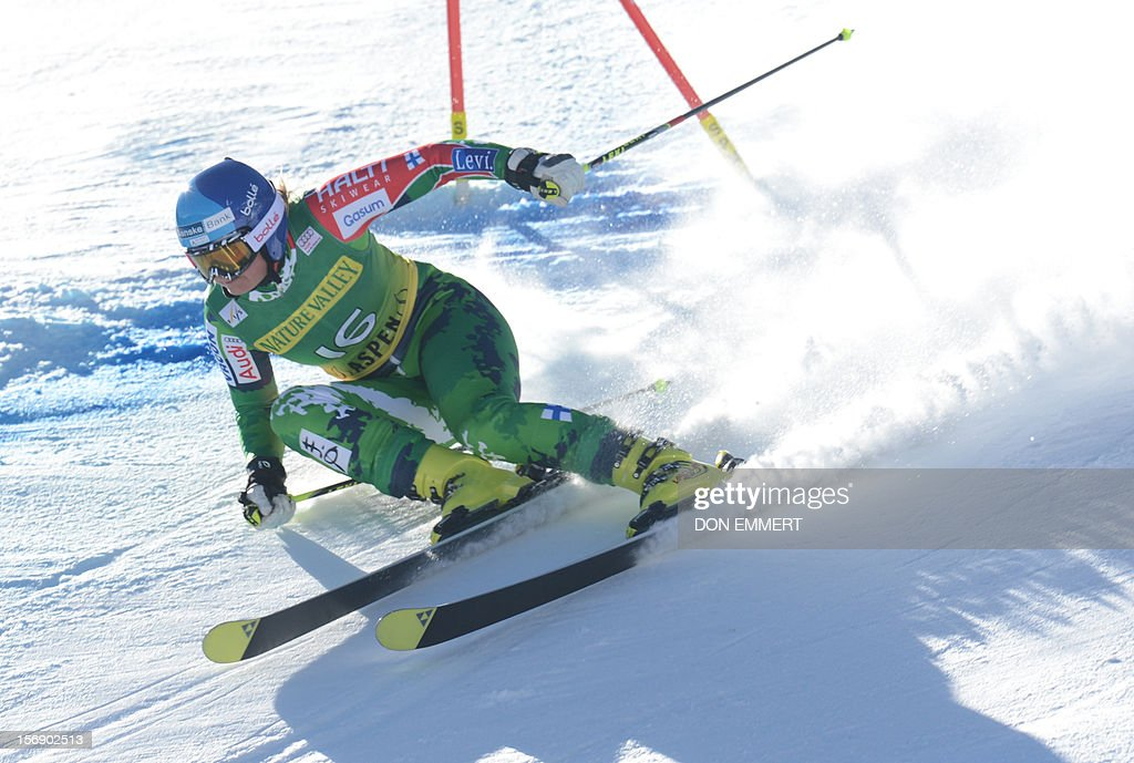 Tanja Poutiainen of Finland clears a gate during the first run of the women's World Cup giant slalom in Aspen on November 24, 2012. AFP PHOTO/Don EMMERT