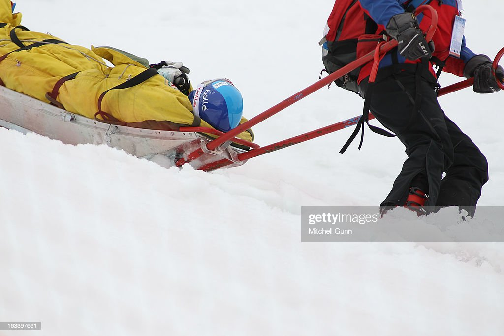 Tanja Poutiainen of Finland is carried down the slope by the first aid sled after crashing whilst competing in the Audi FIS Alpine Ski World Cup...
