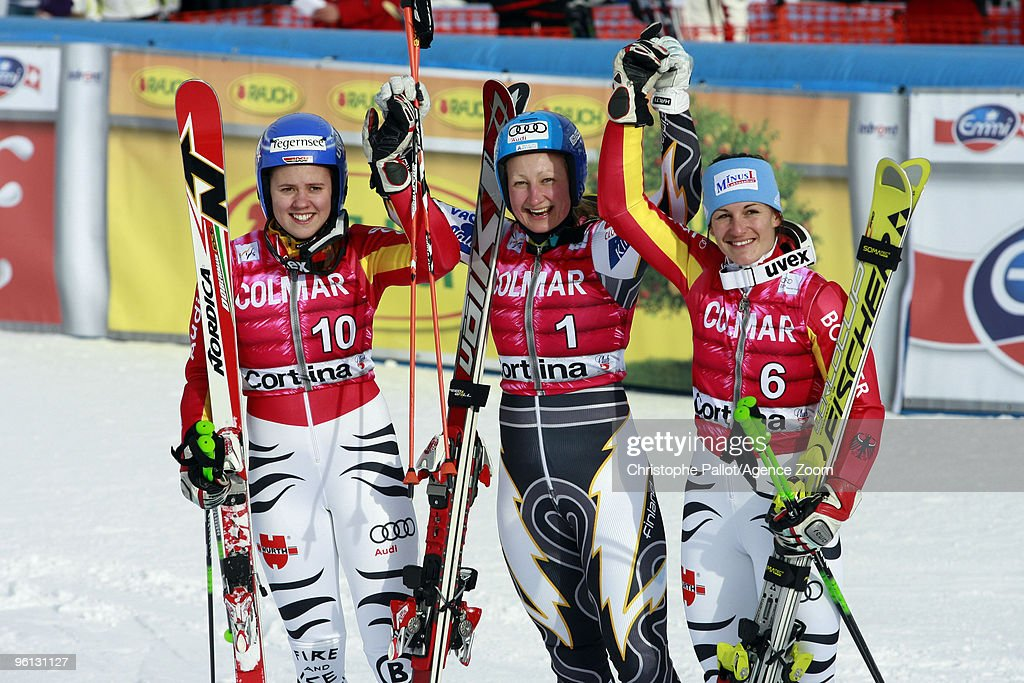 <a gi-track='captionPersonalityLinkClicked' href=/galleries/search?phrase=Tanja+Poutiainen&family=editorial&specificpeople=215271 ng-click='$event.stopPropagation()'>Tanja Poutiainen</a> of Finland takes 1st place, Viktoria Rebensburg of Germany takes 2nd place, <a gi-track='captionPersonalityLinkClicked' href=/galleries/search?phrase=Kathrin+Hoelzl&family=editorial&specificpeople=855457 ng-click='$event.stopPropagation()'>Kathrin Hoelzl</a> of Germany takes 3rd place during the Audi FIS Alpine Ski World Cup Women's Giant slalom on January 24, 2010 in Cortina d'Ampezzo, Italy.