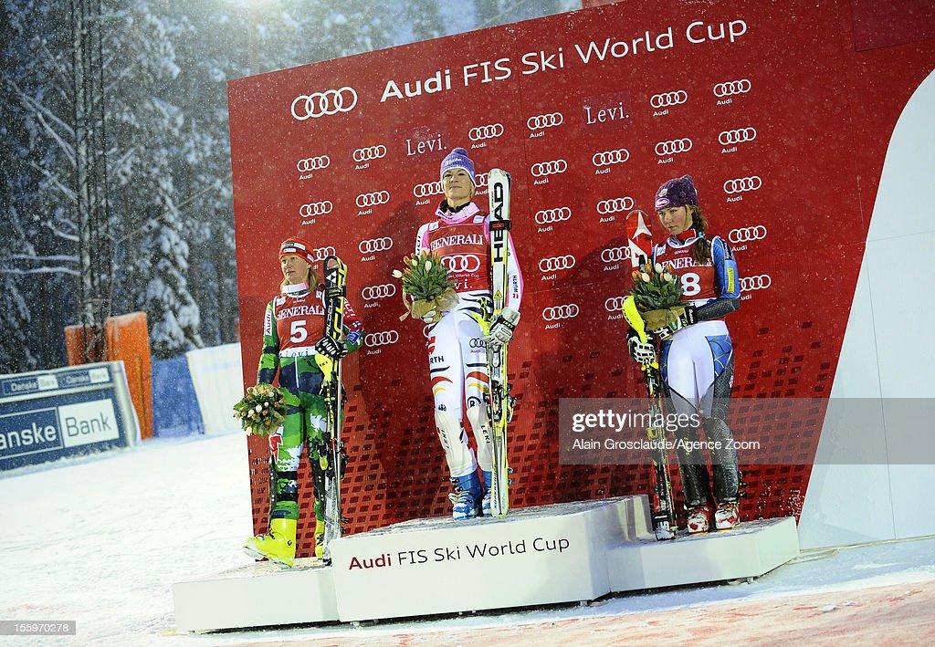 Tanja Poutianen , Maria Hoefl-Riesch ,Mikaela Shiffrin on the podium during the Audi FIS Alpine Ski World Cup Women's Slalom on November 10, 2012 in Levi, Finland.