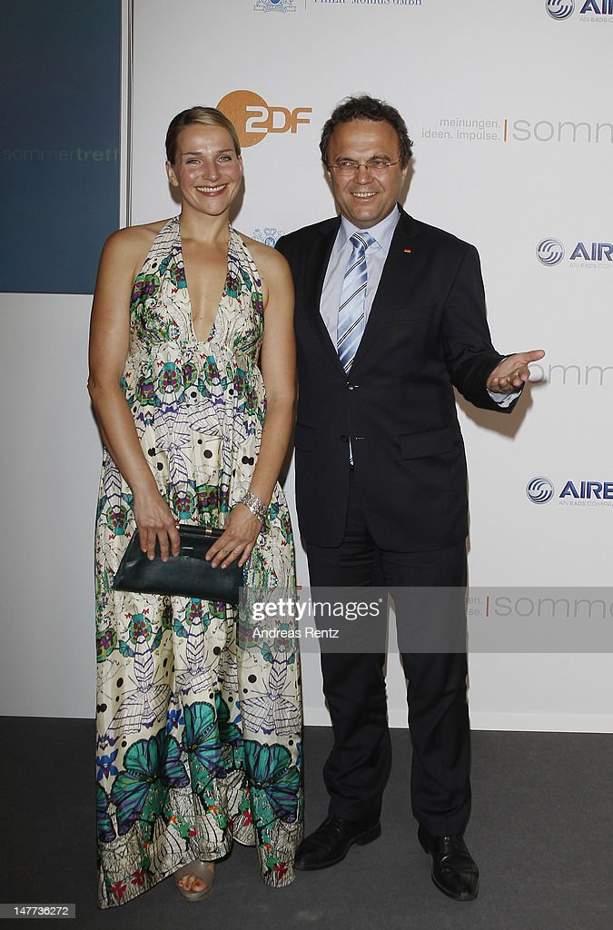 Tanja Wedhorn and German Interior Minister HansPeter Friedrich attend the ZDF summer reception on July 2 2012 in Berlin Germany