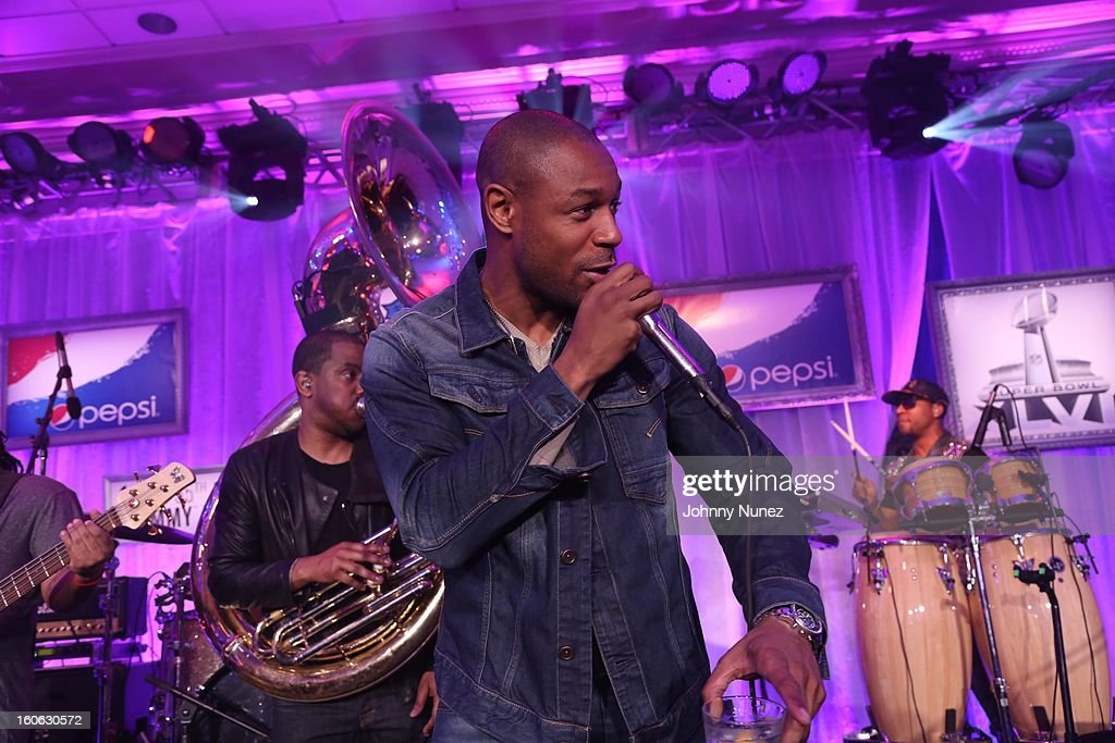 Tank (C) and <a gi-track='captionPersonalityLinkClicked' href=/galleries/search?phrase=The+Roots+-+Band&family=editorial&specificpeople=234784 ng-click='$event.stopPropagation()'>The Roots</a> perform at The Pepsi 5th Quarter on February 3, 2013 in New Orleans, Louisiana.