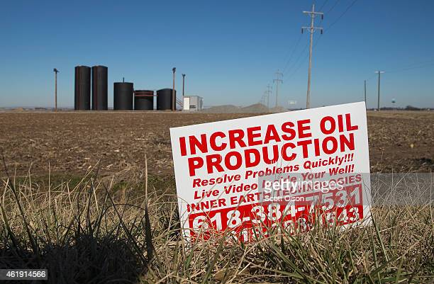 A tank battery used to temporarily store crude oil pumped from the ground sits near an oil well in a farmer's field on January 21 2015 near Ridgway...