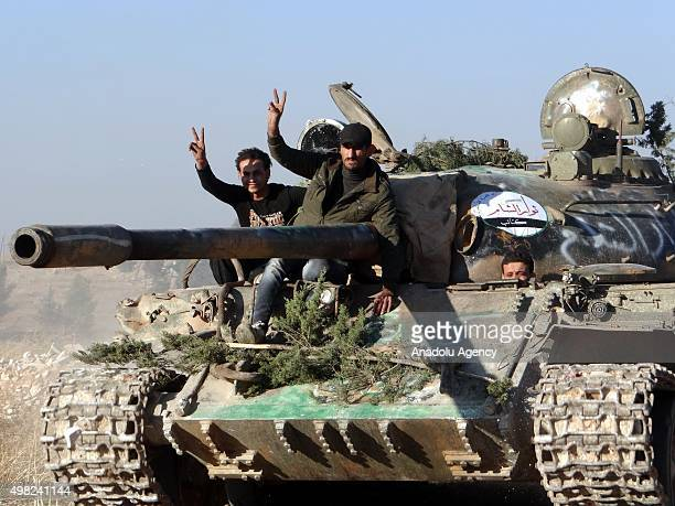A tank belongs to armed opposition groups maneuvers before they attack Assad Regime forces around Khan Tuman town of Aleppo Syria on November 21 2015