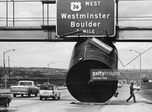 Tank Blocks lane of valley highway after accident A large steel tank remains where it came to rest in an accident on the Valley Highway near 60th Ave...