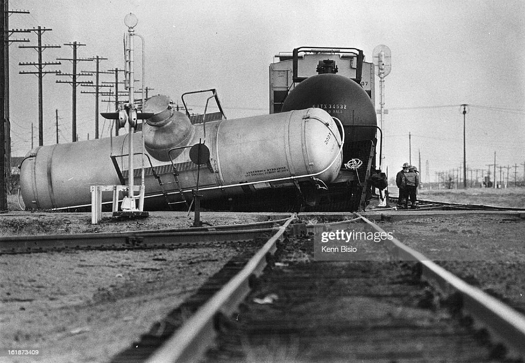 tank car derails denver firemen keep watch at the scene of a pictures getty images. Black Bedroom Furniture Sets. Home Design Ideas