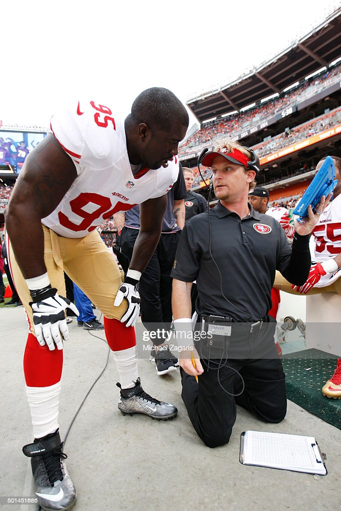 <a gi-track='captionPersonalityLinkClicked' href=/galleries/search?phrase=Tank+Carradine&family=editorial&specificpeople=10915724 ng-click='$event.stopPropagation()'>Tank Carradine</a> #95 and Linebackers Coach <a gi-track='captionPersonalityLinkClicked' href=/galleries/search?phrase=Jason+Tarver&family=editorial&specificpeople=649692 ng-click='$event.stopPropagation()'>Jason Tarver</a> of the San Francisco 49ers talk on the sideline during the game against the Cleveland Browns at Browns Stadium on December 13, 2015 in Cleveland, Ohio. The Browns defeated the 49ers 24-10.