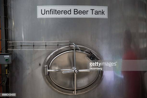 A tank containing unfiltered beer sits in the brew house at the Heineken NV brewery in Yangon Myanmar on June 15 2017 Heineken is seeking to exploit...