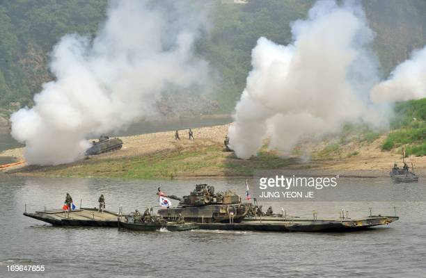 M1A2 tank crosses a river on a South Korean military barge during a USSouth Korea joint river crossing exercise in the border city of Yeoncheon...