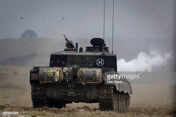 A tank fires during Exercise Tractable on March 19 2015 in Salisbury England The threeweek major exercise involving hundreds of vehicles including...