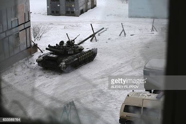 A tank from the Ukrainian Forces is stationed outside a building in the flashpoint eastern town of Avdiivka that sits just north of the proRussian...