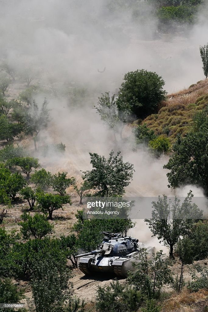 Tank is in action during the Efes-2016 Combined Joint Live Fire Exercise at Seferihisar district of Izmir, Turkey on May 31, 2016. The Turkish-led multinational military exercises, Efes-2016 which started at 04 May and will be finished at 04 June 2016, aims to train participating units and staff in planning and conducting combined and joint operations, including logistics and command-control as well as to improve the level of interoperability among headquarters and forces.