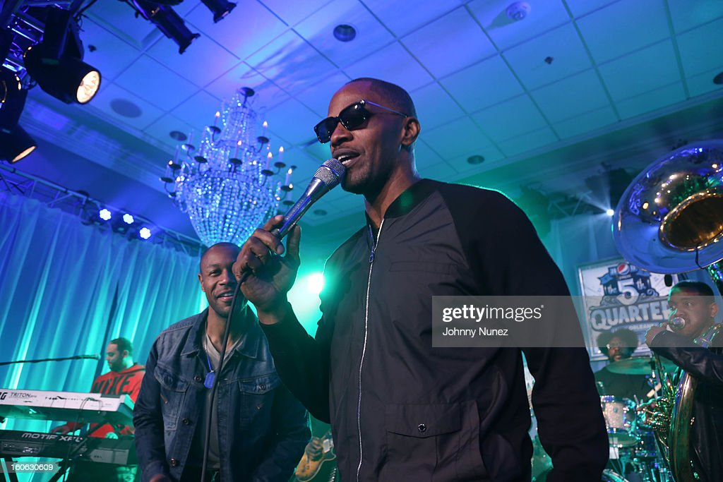 Tank, <a gi-track='captionPersonalityLinkClicked' href=/galleries/search?phrase=Jamie+Foxx&family=editorial&specificpeople=201715 ng-click='$event.stopPropagation()'>Jamie Foxx</a> and <a gi-track='captionPersonalityLinkClicked' href=/galleries/search?phrase=The+Roots+-+Band&family=editorial&specificpeople=234784 ng-click='$event.stopPropagation()'>The Roots</a> perform at The Pepsi 5th Quarter on February 3, 2013 in New Orleans, Louisiana.