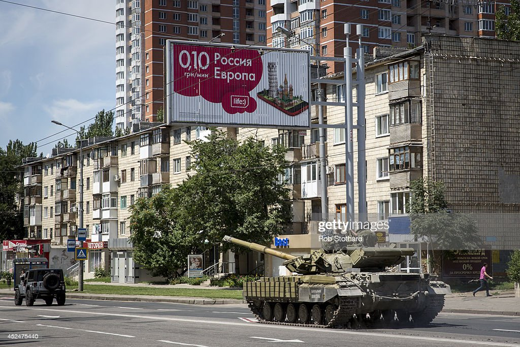 A tank operated by pro-Russia rebels is driven down Artena in the direction of the central railway station on July 21, 2014 in Donetsk, Ukraine. Local authorities warned residents in the area not to go outside or leave their homes whilst intense shelling set a market ablaze close to the station. The security situation is continuing to affect the investigation into the Malaysian Airlines flight MH17 crash and it is still unclear where or when the train containing the bodies of victims will be moved. Malaysian Airlines flight MH17 was travelling from Amsterdam to Kuala Lumpur when it crashed killing all 298 on board including 80 children. The aircraft was allegedly shot down by a missile and investigations continue over the perpetrators of the attack.