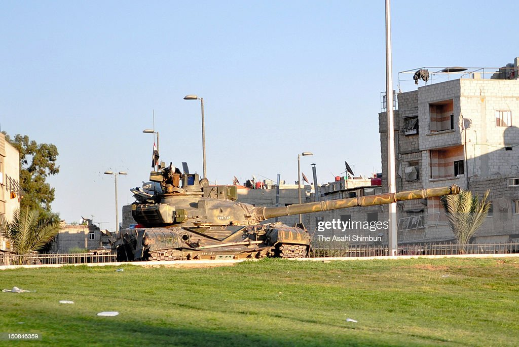 A Tank rolling out on streets of residential area after the departure of UNSMIS, showing President Bashar al-Assad's hardening attitude towards the anti-government activists on August 23, 2012 in Damascus, Syria.