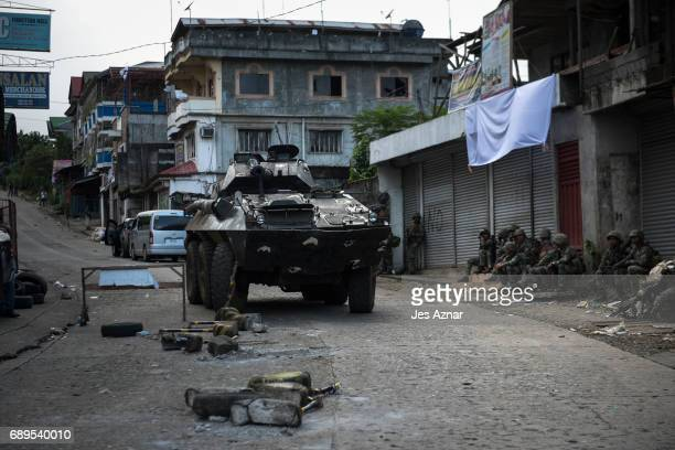 A tank rolls out on a street inside the city supported by marines to clear a street of armed militants on May 28 2017 in Marawi city southern...