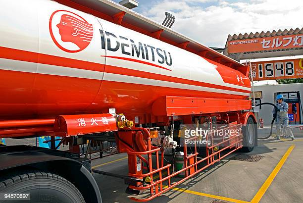 A tank truck driver prepares to pump out gasoline and other fuels into reserve tanks at an Idemitsu Kosan Co gas station in Tokyo Japan on Monday Nov...