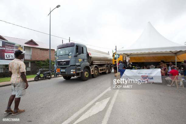 A tank truck drives past a road block at an outoffuel petrol station on March 26 in Cayenne French Guiana during a string of regionwide protests and...