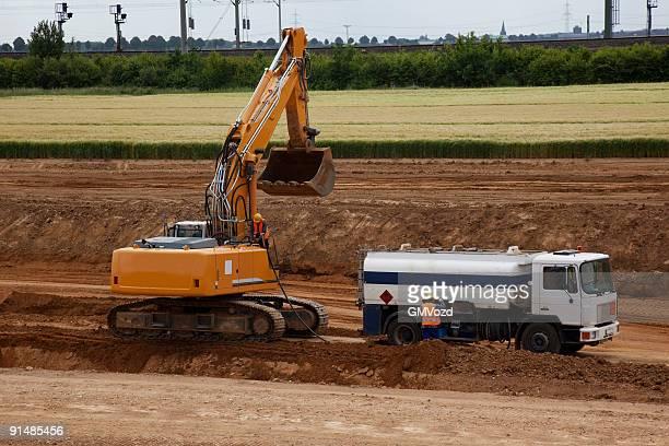Tank truck filling bulldozer