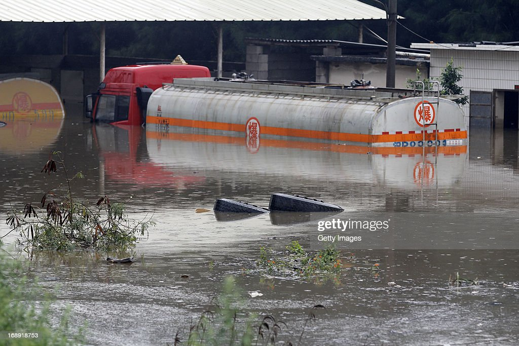 A tank truck is submerged by flood waters at a petrochemical company on May 16, 2013 in Jinjiang, China. A round of rainstorms hit South China since Tuesday, leaving 33 people dead and 12 missing.