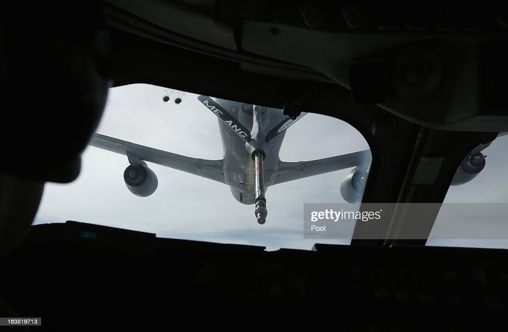 A KC-135 tanker aircraft is pictured during a mid-air refueling of U.S. Secretary of Defense Chuck Hagel's E-4B, a militarized version of a Boeing 747, as he returns from Ramstein Airbase in Germany to Andrews Air Force Base near Washington, over Newfoundland on March 11, 2013 in Flight. Hagel was on a three day visit to Afghanistan.