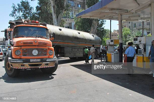 A tanker arrives at a petrol station as Syrians wait for fuel in Damascus on July 22 2012 An activist who identified himself as Abu Omar told AFP via...