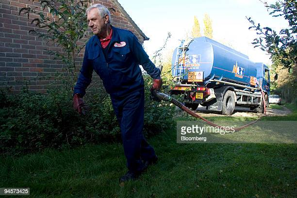 Tanker driver Bill Webb of Marsh Fuels delivers domestic heating oil to a house in Newbury Berkshire UK on Tuesday Oct 30 2007 Crude oil fell from a...