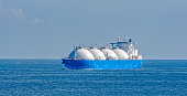 Liquefied natural gas (LNG) tanker is passing by Strait of Singapore.