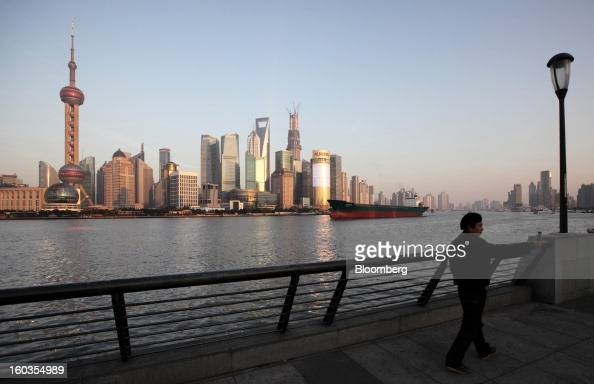 A tanker sails past commercial buildings in the Pudong area seen from the Bund in Shanghai China on Monday Jan 28 2013 China's economic growth...