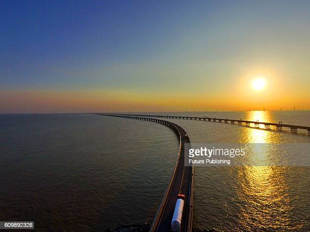 A tanker seen leaving the PetroChina liquefied natural gas import terminal runs on a bridge on the Yellow Sea on September 22 2016 in Rudong China...