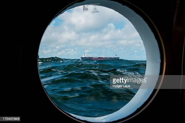 Tanker seen through porthole window