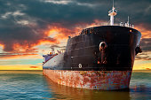 Big ship at sea on a background of sunset sky.