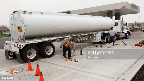 A tanker truck delivers gasoline to a Costco store's gas station May 19 2005 in Mount Prospect Illinois Some groceries and supermarkets as well as...