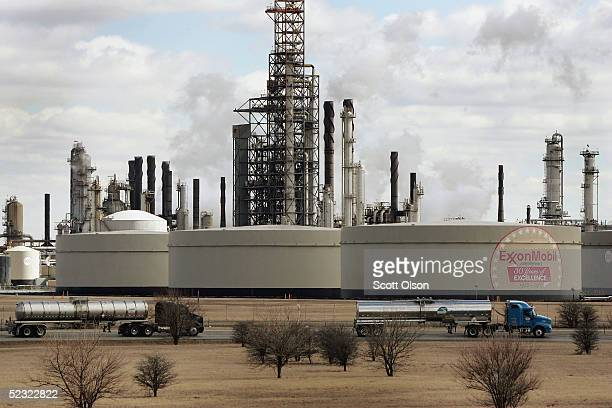 Tanker trucks drive past an ExxonMobil oil refinery March 8 2005 in Joliet Illinois Gasoline prices nationwide have climbed in the past two weeks and...